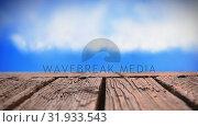 Купить «Wooden deck and sky», видеоролик № 31933543, снято 27 марта 2019 г. (c) Wavebreak Media / Фотобанк Лори