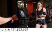 Купить «Woman exercising in fitness studio 4k», видеоролик № 31933639, снято 26 июня 2018 г. (c) Wavebreak Media / Фотобанк Лори