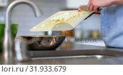 Купить «Man preparing food in kitchen at home 4k», видеоролик № 31933679, снято 18 апреля 2018 г. (c) Wavebreak Media / Фотобанк Лори