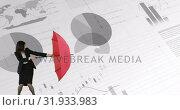 Купить «Businesswoman braving a storm of statistics and graphs 4k», видеоролик № 31933983, снято 5 апреля 2019 г. (c) Wavebreak Media / Фотобанк Лори