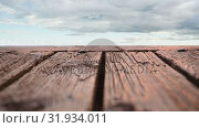Купить «Wooden deck with a view of cloudy skies», видеоролик № 31934011, снято 5 апреля 2019 г. (c) Wavebreak Media / Фотобанк Лори