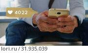 Купить «Man sitting in the office while browsing on his phone 4k», видеоролик № 31935039, снято 5 апреля 2019 г. (c) Wavebreak Media / Фотобанк Лори