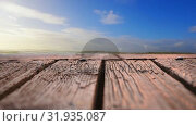 Купить «Wooden deck with a view of blue skies», видеоролик № 31935087, снято 5 апреля 2019 г. (c) Wavebreak Media / Фотобанк Лори