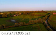 Купить «Beautiful farmland on a sunny day 4k», видеоролик № 31935523, снято 23 мая 2018 г. (c) Wavebreak Media / Фотобанк Лори