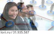 Купить «Group of call centre agents taking calls», видеоролик № 31935587, снято 5 апреля 2019 г. (c) Wavebreak Media / Фотобанк Лори