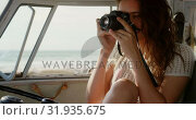 Купить «Young woman taking photo with digital camera 4k», видеоролик № 31935675, снято 9 января 2019 г. (c) Wavebreak Media / Фотобанк Лори