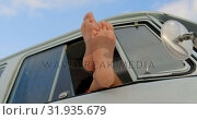 Купить «Relaxing with feet up in camper van at beach 4k», видеоролик № 31935679, снято 9 января 2019 г. (c) Wavebreak Media / Фотобанк Лори