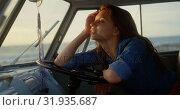 Купить «Woman relaxing in camper van at beach 4k», видеоролик № 31935687, снято 9 января 2019 г. (c) Wavebreak Media / Фотобанк Лори