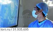 Купить «Male surgeon examining x-ray report 4k», видеоролик № 31935695, снято 26 января 2019 г. (c) Wavebreak Media / Фотобанк Лори