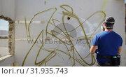 Купить «Graffiti artist looking at the wall 4k», видеоролик № 31935743, снято 4 февраля 2019 г. (c) Wavebreak Media / Фотобанк Лори