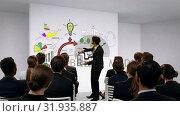 Купить «Businessman discussing presentation to colleagues», видеоролик № 31935887, снято 27 марта 2019 г. (c) Wavebreak Media / Фотобанк Лори