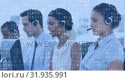 Купить «Call centre agents working and binary codes», видеоролик № 31935991, снято 5 апреля 2019 г. (c) Wavebreak Media / Фотобанк Лори
