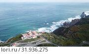 Купить «Scenic aerial view of rocky Atlantic coast of Cabo da Roca in sunny spring day, Portugal», видеоролик № 31936275, снято 21 апреля 2019 г. (c) Яков Филимонов / Фотобанк Лори