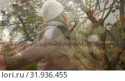 Купить «Woman dancing under the trees», видеоролик № 31936455, снято 5 апреля 2019 г. (c) Wavebreak Media / Фотобанк Лори