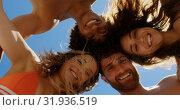 Купить «Young friends forming huddle at beach 4k», видеоролик № 31936519, снято 9 января 2019 г. (c) Wavebreak Media / Фотобанк Лори