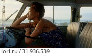 Купить «Woman relaxing in camper van at beach 4k», видеоролик № 31936539, снято 9 января 2019 г. (c) Wavebreak Media / Фотобанк Лори