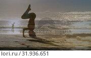 Купить «Woman doing yoga on the beach at sunset», видеоролик № 31936651, снято 18 апреля 2019 г. (c) Wavebreak Media / Фотобанк Лори