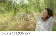 Купить «Woman relaxing at a forest», видеоролик № 31936927, снято 5 апреля 2019 г. (c) Wavebreak Media / Фотобанк Лори