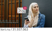 Woman leaning on a wall near the door while texting 4k. Стоковое видео, агентство Wavebreak Media / Фотобанк Лори