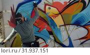 Купить «Graffiti artist painting with aerosol spray 4k», видеоролик № 31937151, снято 4 февраля 2019 г. (c) Wavebreak Media / Фотобанк Лори