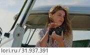 Купить «Woman taking photos with digital camera 4k», видеоролик № 31937391, снято 9 января 2019 г. (c) Wavebreak Media / Фотобанк Лори