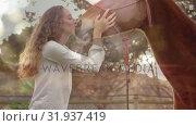 Woman kissing a horse at farm. Стоковое видео, агентство Wavebreak Media / Фотобанк Лори