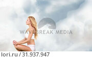 Купить «Woman seated on the sky meditating», видеоролик № 31937947, снято 25 апреля 2019 г. (c) Wavebreak Media / Фотобанк Лори