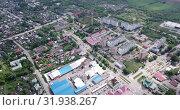 Купить «Aerial view of modern residential areas of small Russian city of Ozyory in sunny spring day», видеоролик № 31938267, снято 13 мая 2019 г. (c) Яков Филимонов / Фотобанк Лори