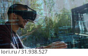 Купить «Man smiling while wearing a virtual reality headset», видеоролик № 31938527, снято 25 апреля 2019 г. (c) Wavebreak Media / Фотобанк Лори