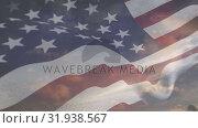 Clear sky with an American flag waving . Стоковое видео, агентство Wavebreak Media / Фотобанк Лори