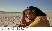 Купить «Woman in sunglasses relaxing on the beach 4k», видеоролик № 31938747, снято 8 февраля 2019 г. (c) Wavebreak Media / Фотобанк Лори