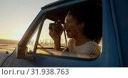 Купить «Woman taking photo with digital camera in pickup truck at beach 4k», видеоролик № 31938763, снято 8 февраля 2019 г. (c) Wavebreak Media / Фотобанк Лори