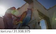 Купить «Graffiti artist painting with aerosol spray 4k», видеоролик № 31938975, снято 4 февраля 2019 г. (c) Wavebreak Media / Фотобанк Лори