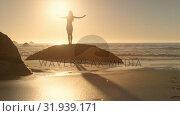 Купить «Silhouette of a woman spreading arms at the beach», видеоролик № 31939171, снято 8 мая 2019 г. (c) Wavebreak Media / Фотобанк Лори