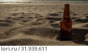 Купить «Beer bottle on sand at beach 4k», видеоролик № 31939611, снято 8 февраля 2019 г. (c) Wavebreak Media / Фотобанк Лори