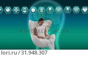Купить «Woman sitting on a chair with an illustration of human head», видеоролик № 31948307, снято 24 мая 2019 г. (c) Wavebreak Media / Фотобанк Лори