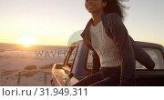 Купить «Woman sitting on trunk of pickup truck at beach 4k», видеоролик № 31949311, снято 8 февраля 2019 г. (c) Wavebreak Media / Фотобанк Лори