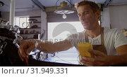 Купить «Male mechanic checking battery of motorbike in repair garage 4k», видеоролик № 31949331, снято 10 февраля 2019 г. (c) Wavebreak Media / Фотобанк Лори