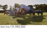 Купить «Female soccer players doing push ups on soccer field. 4k», видеоролик № 31950583, снято 18 апреля 2019 г. (c) Wavebreak Media / Фотобанк Лори