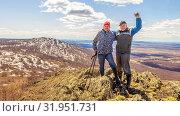 Купить «Two friends are standing on the top of the mountain, enjoying the ascent.», фото № 31951731, снято 25 апреля 2019 г. (c) Акиньшин Владимир / Фотобанк Лори