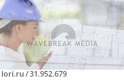 Купить «Architect looking at plans», видеоролик № 31952679, снято 13 июня 2019 г. (c) Wavebreak Media / Фотобанк Лори