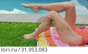 Купить «Woman in swimwear relaxing near poolside in the backyard 4k», видеоролик № 31953083, снято 12 марта 2019 г. (c) Wavebreak Media / Фотобанк Лори