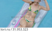 Купить «Woman relaxing with hands behind head on inflatable tube in pool 4k», видеоролик № 31953323, снято 12 марта 2019 г. (c) Wavebreak Media / Фотобанк Лори