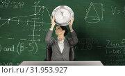 Купить «Woman holding clock sitting in front of chalkboard with moving maths calculations on it 4k», видеоролик № 31953927, снято 5 июля 2019 г. (c) Wavebreak Media / Фотобанк Лори