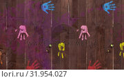 Купить «Pink paint covering handprints on wooden boards», видеоролик № 31954027, снято 8 июля 2019 г. (c) Wavebreak Media / Фотобанк Лори