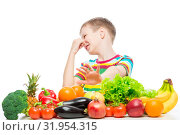 Concept photo of an unloved food - portrait of a boy with an aversion to vegetables and fruits on a white background. Стоковое фото, фотограф Константин Лабунский / Фотобанк Лори