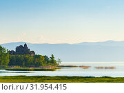 Купить «Morning on lake Sevan, view of the monastery on the lake in the rays of the rising sun, landscape of Armenia», фото № 31954415, снято 7 июня 2018 г. (c) Константин Лабунский / Фотобанк Лори
