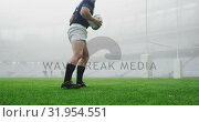 Купить «Male rugby player tying shoelaces in the stadium 4k», видеоролик № 31954551, снято 9 мая 2019 г. (c) Wavebreak Media / Фотобанк Лори