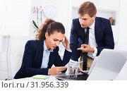 Купить «Sad subordinate woman being accused to making mistake by man colleague», фото № 31956339, снято 4 апреля 2020 г. (c) Яков Филимонов / Фотобанк Лори