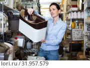 Young woman choosing purpose basket. Стоковое фото, фотограф Яков Филимонов / Фотобанк Лори